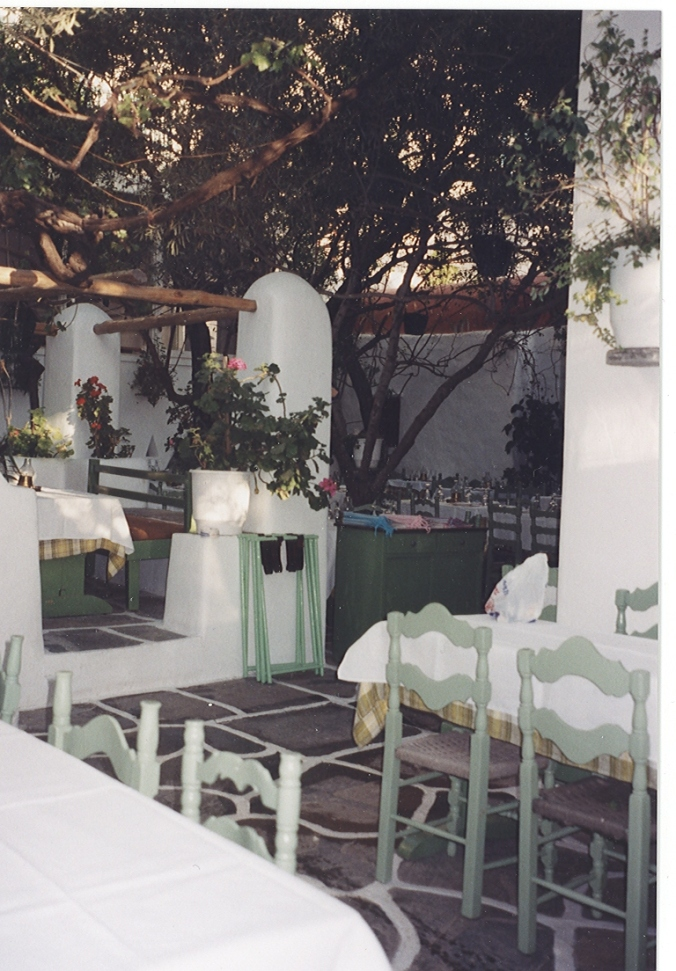 "Not necessarily a garden in the ""garden"" sense of the word, but a tree-covered courtyard on Mykonos is an ideal location for an early dinner."