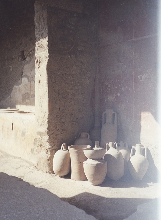 Maybe not a garden, but a photo of my other favorite -- clay pots.  These were in Pompeii -- amazing to think of the hands that created them, carried them, worked from them, were buried with them.