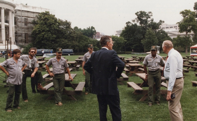 "President Bush meets with ""Master of the Grounds"" Irv Williams (far right) and the White House grounds crew. Photo courtesy of Bush Presidential Library."