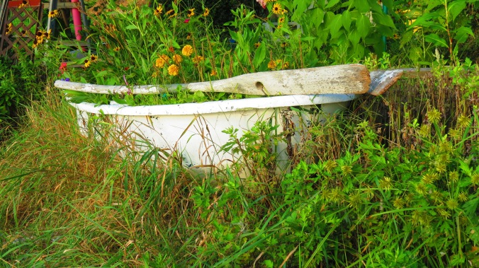 An old dinghy, now a planter, feels at home in this shore-hugging garden.