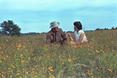 President Johnson and First Lady Ladybird Johnson share a quiet moment in a field of wildflowers.   Photo courtesy of LBJ Presidential Library.