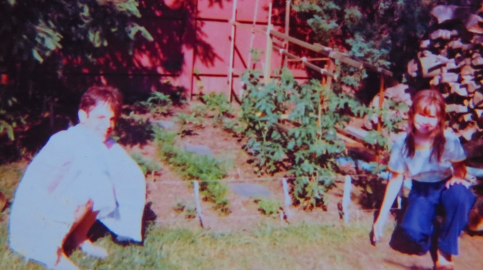 Me and my sister by the vegetable garden -- a long time ago.